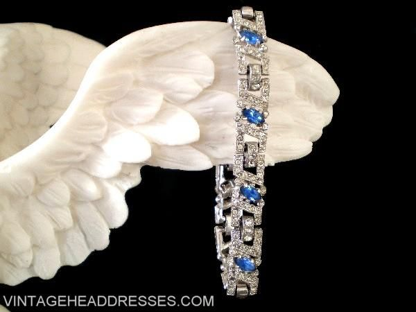 Fabulous early vintage art deco diamante bracelet, with masses of sparkling clear pave-set stones, and beautiful sapphire blue marquise stones. In beautiful condition with an elegant fold-over clasp to fasten. Your perfect Something Blue?