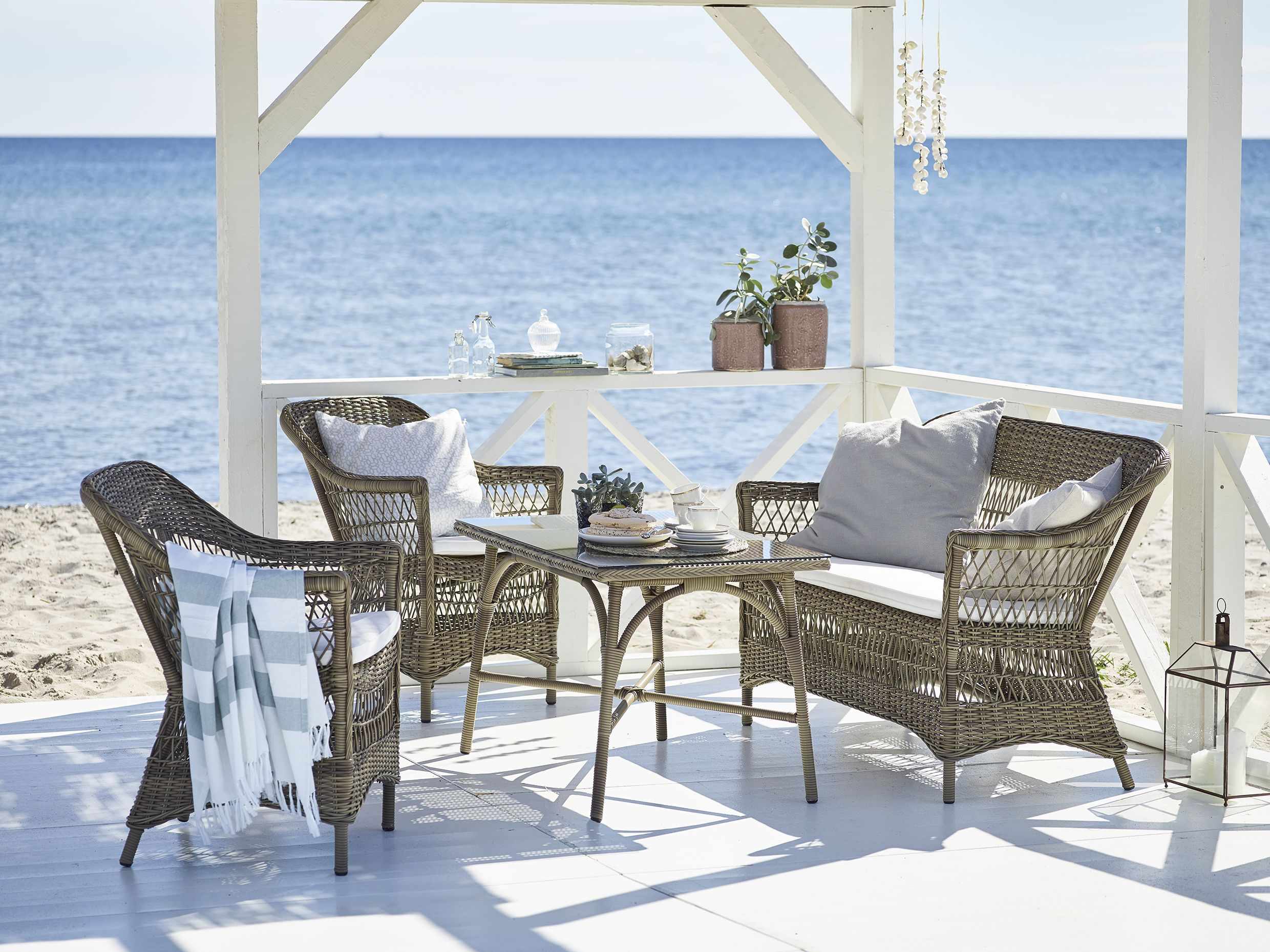 Patio at the beach charlot 2 seater and chairs designed for outdoor use
