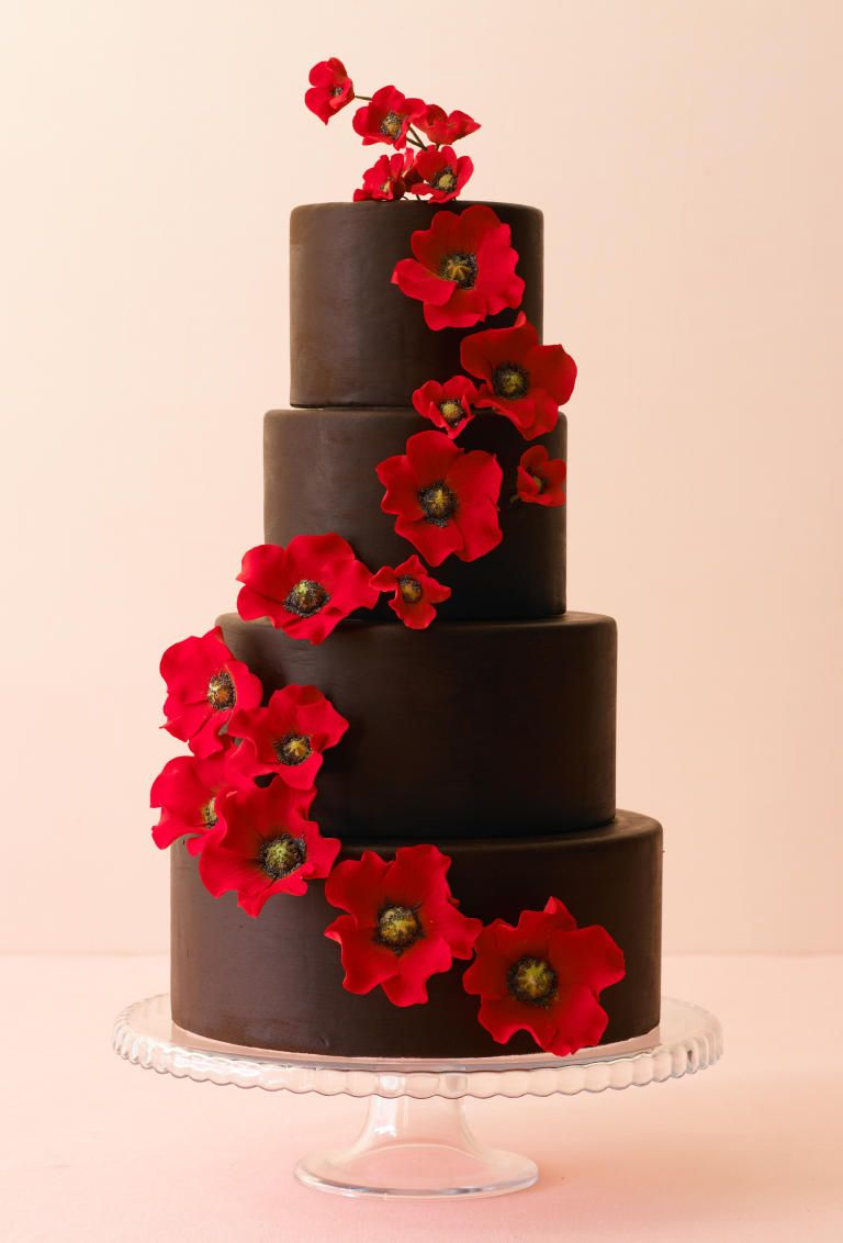 Don't feel the need to get white buttercream on a chocolate wedding cake. Choose creamy chocolate buttercream, smooth ganache, fondant or chocolate marzipan instead.