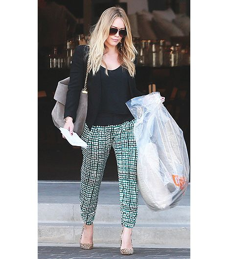 @Who What Wear - Hilary Duff                 We love this simple yet ultra flattering look, courtesy of Duff. Her solid black top and cardigan complement her printed Parker Abbey Silk Pants ($90) for a well-balanced ensemble. If you're up for the challenge, try a pair of nude pumps like Duff for a polished look.