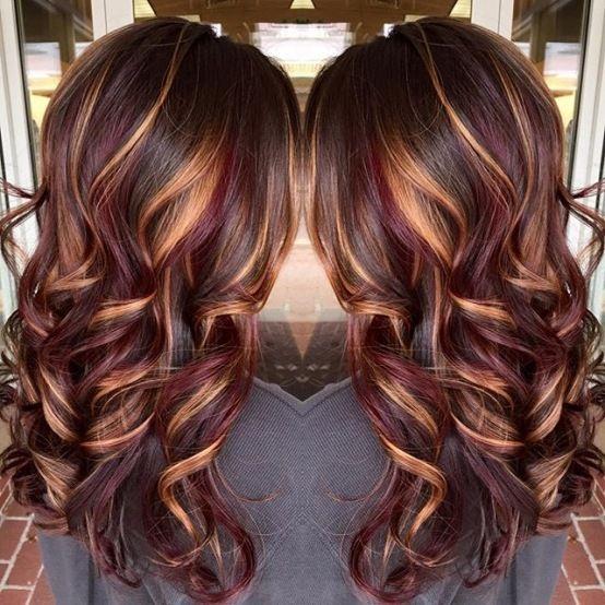 Brunette hair color with burnished blonde highl...