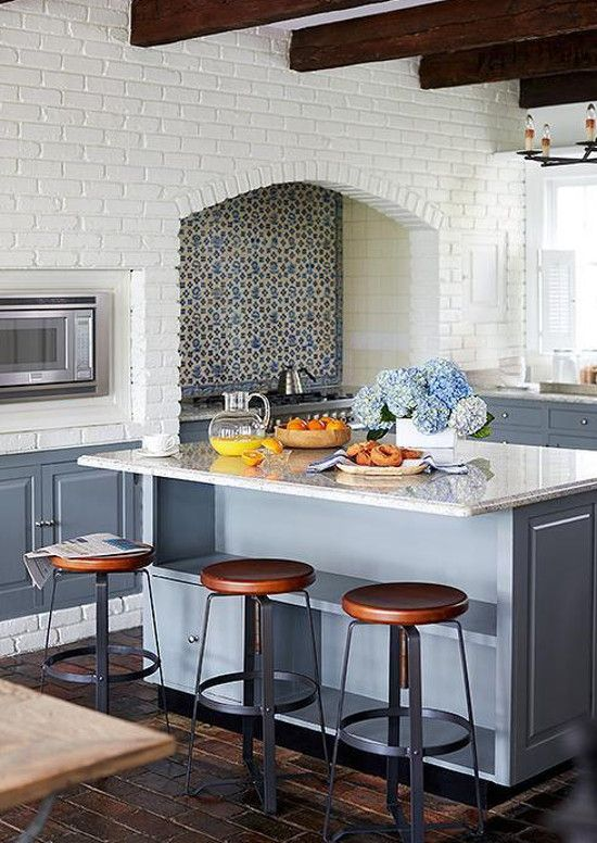 blue and white vintage floral Delft tile backsplash in a renovated