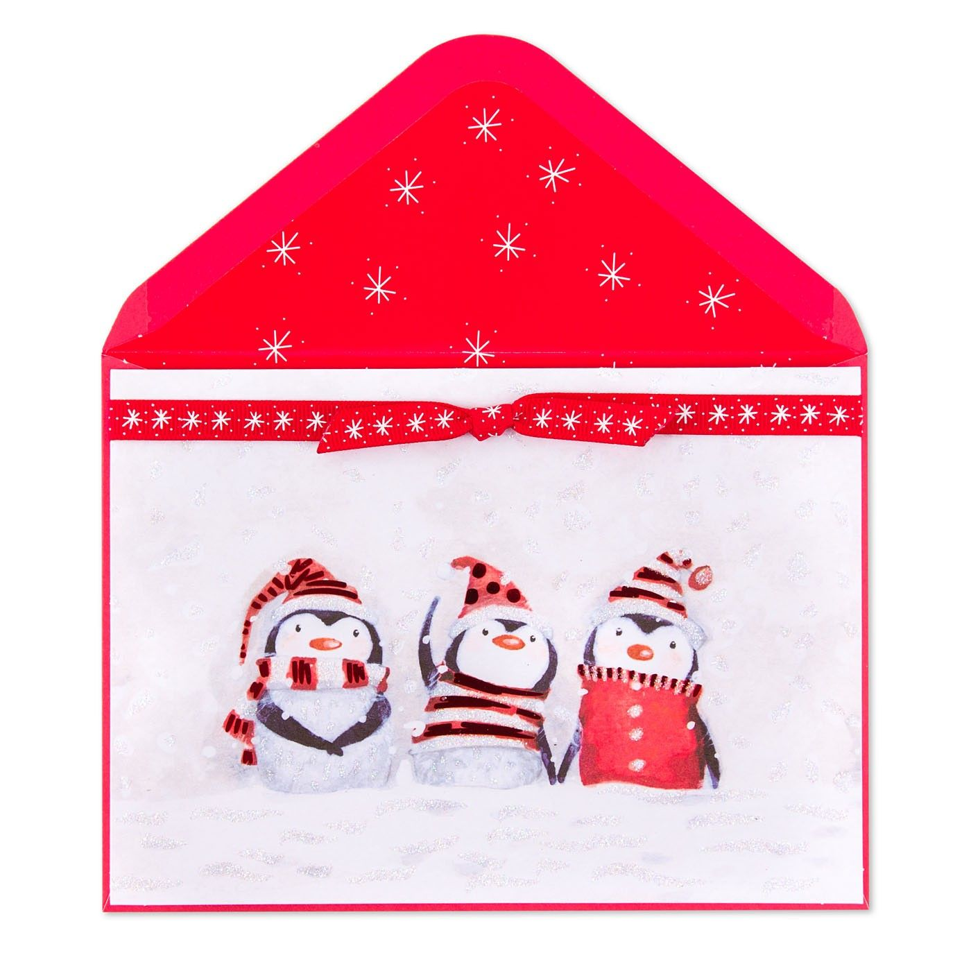 Wish them a merry Christmas with this adorable card featuring three penguins wearing Santa hats, sweaters, and a scarf.
