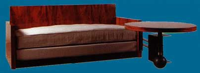 Pierre Chareau (1883-1950), Brazilian rose-wood couch with fixed pivoting circular table