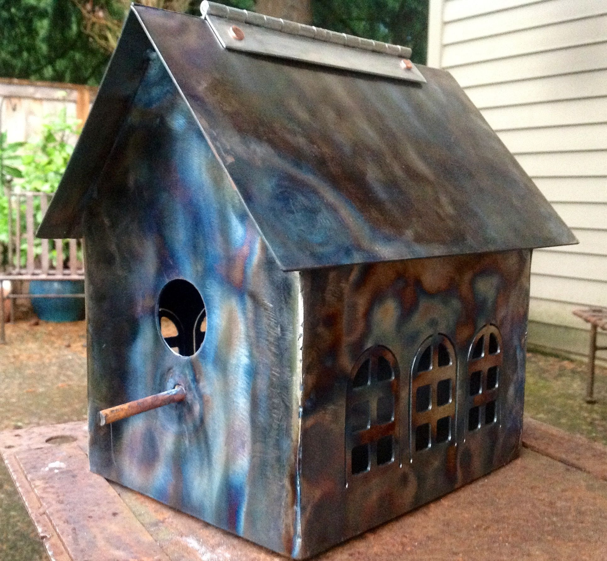 Welded steel birdhouse heat treated with the welding torch to create ...