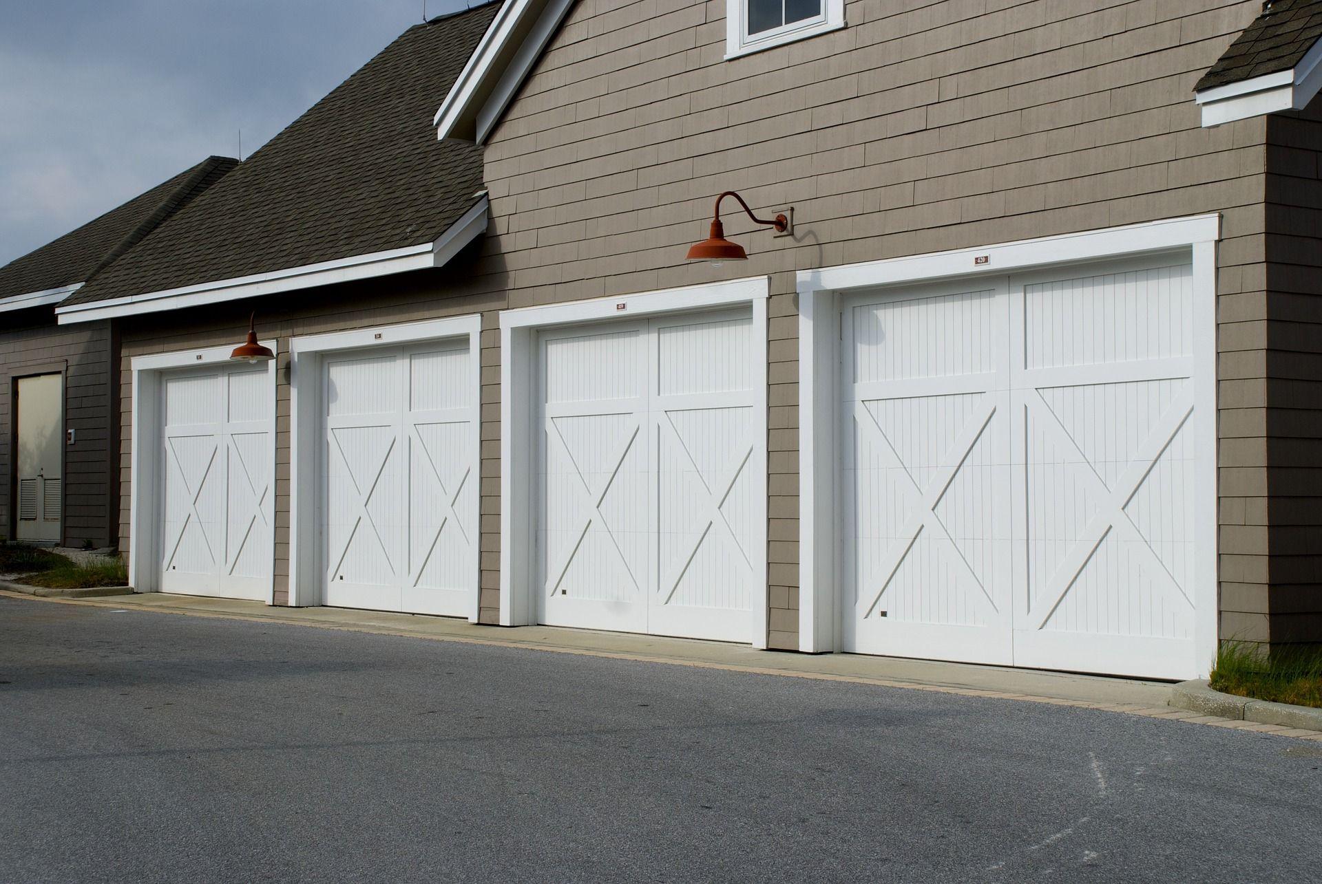 Common Problems With Garage Door Openers How To Fix Them Garage Doors Garage Door Installation Garage Door Springs