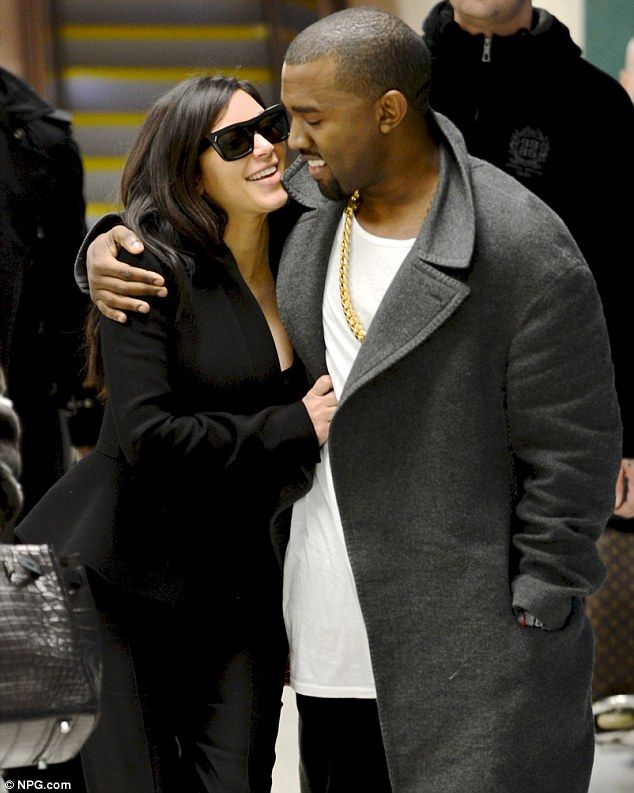 9f259dd5f Here come the happy couple  Pregnant Kim Kardashian and her boyfriend Kanye  West had big smiles as they arrived at Los Angeles Airport on Monday