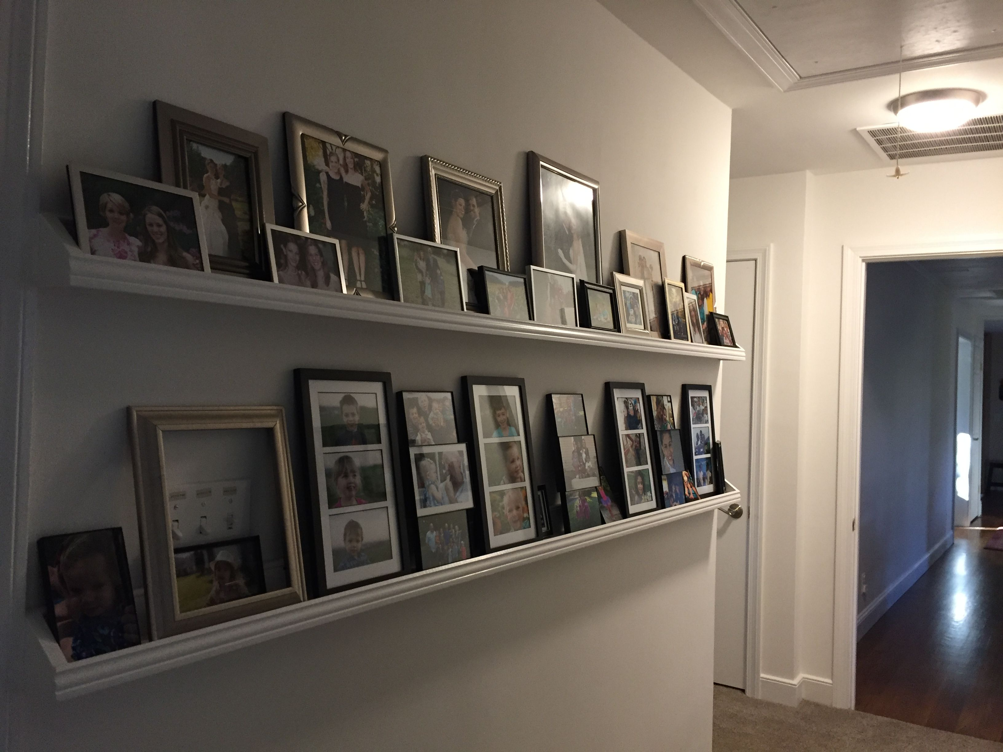 Double Picture shelves. Eight feet long. Resolved the problem of hanging pictures of our 12 grandchildren.