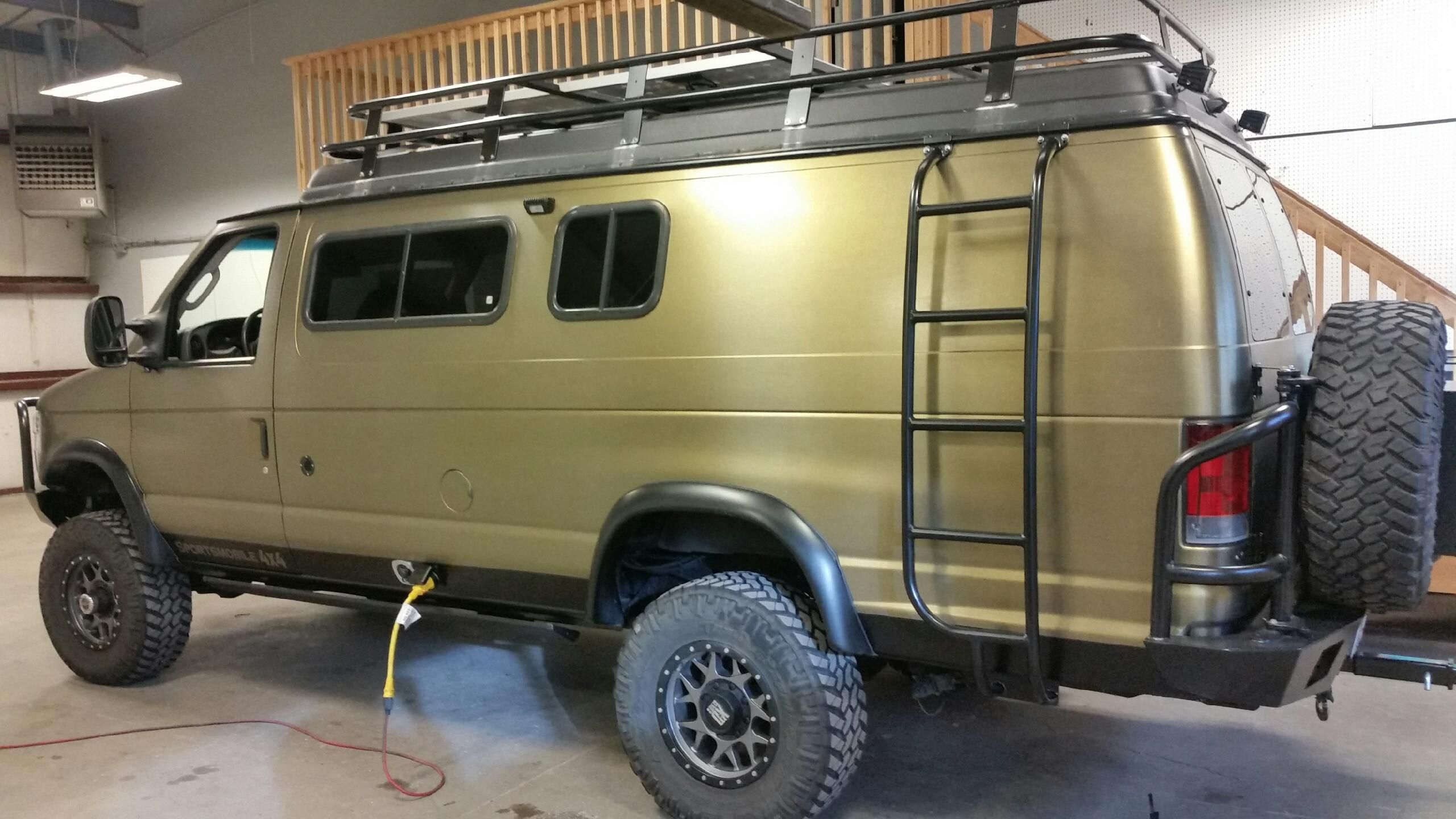 Sportsmobile With Aluminess Bumpers Ladder And Roof Rack