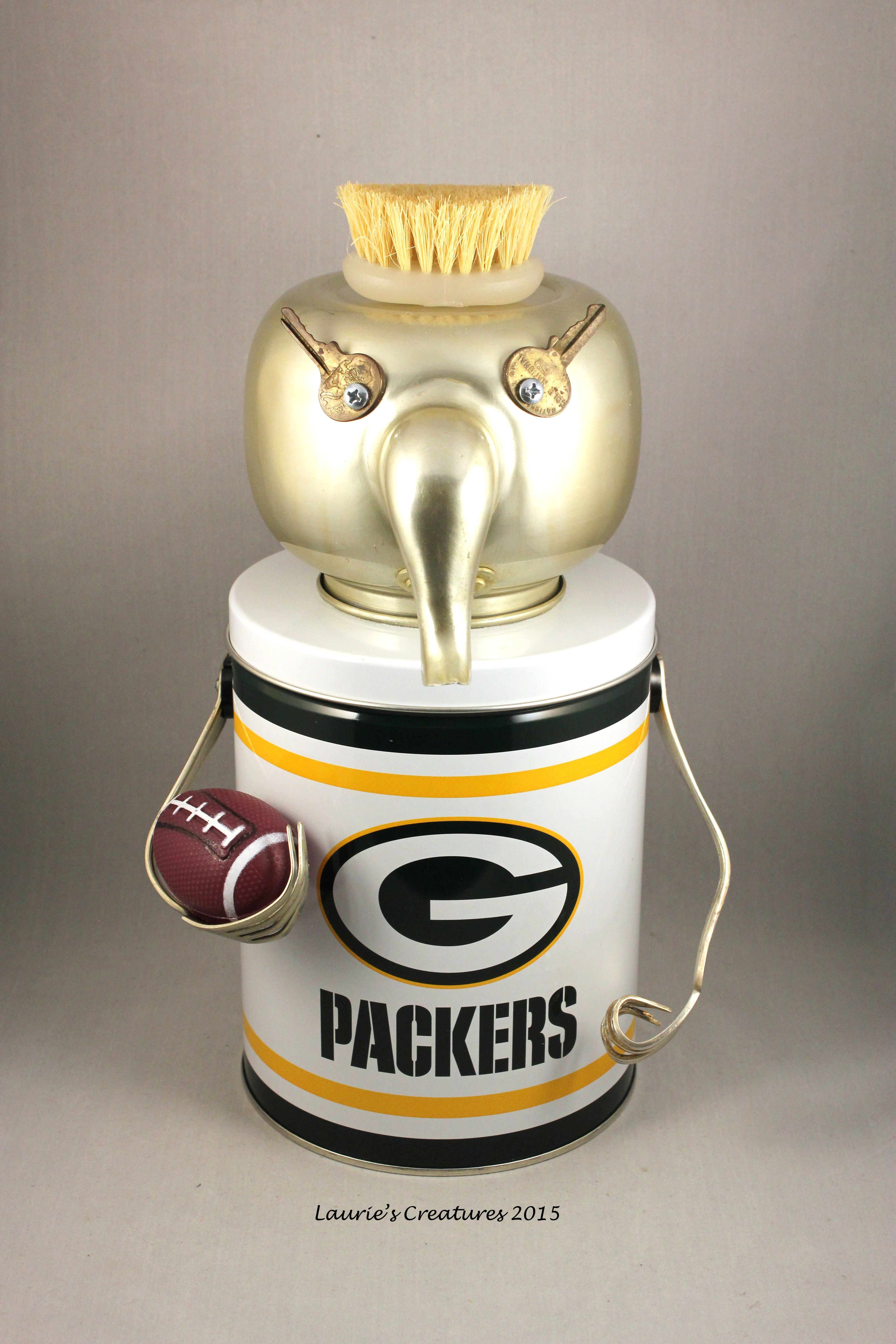 """""""Packer Backer"""" ~ Original found object/junk art created by Laurie Schnurer in 2015. The tin opens to store things inside."""