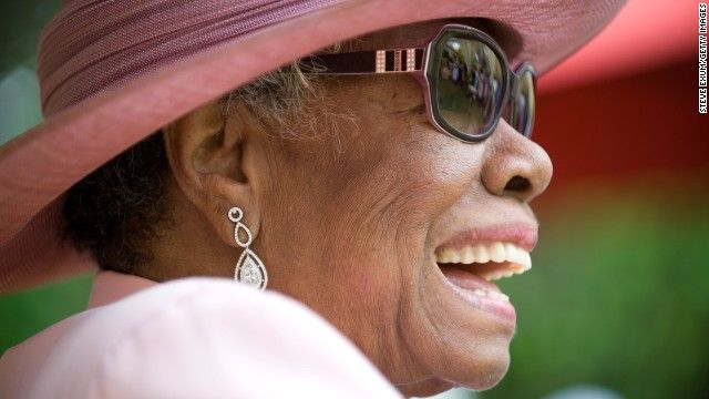 Maya Angelou laughs during her 82nd birthday party at her home in Winston-Salem, North Carolina, in 2010.