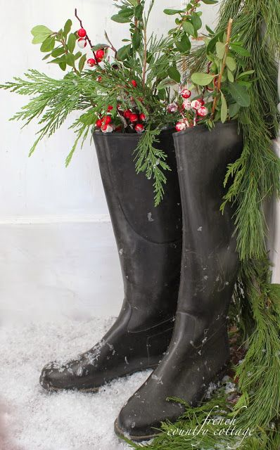 Christmas/winter greenery and berries tucked into black garden/rain boots! Charming! French Country Cottage site,