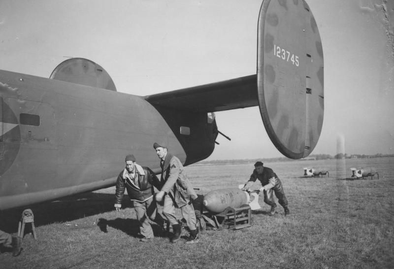 Ground Personnel Of The 93rd Bomb Group Drag A Bomb Towards A B 24 Liberator Serial Number 41 23745 Nicknamed American Air Air Force Bomber Military History