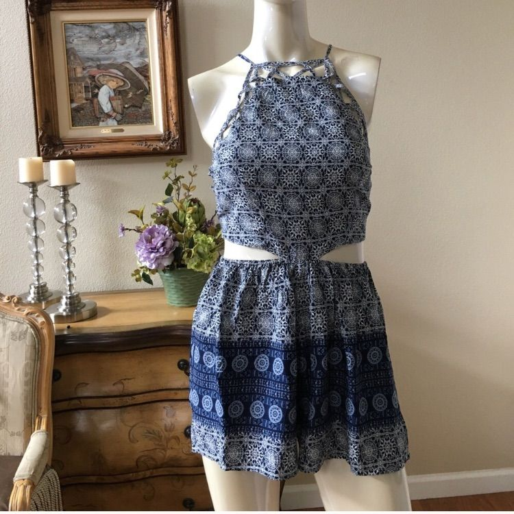 Milau Romper With Cutouts.Tagged For Exposure