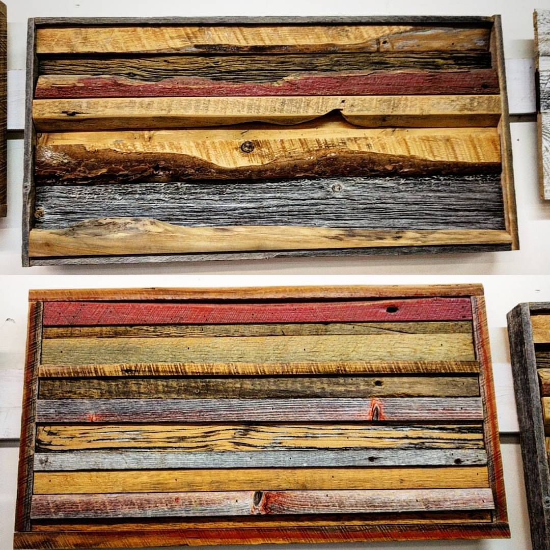 Two reclaimed barn board wall art pieces at the shop