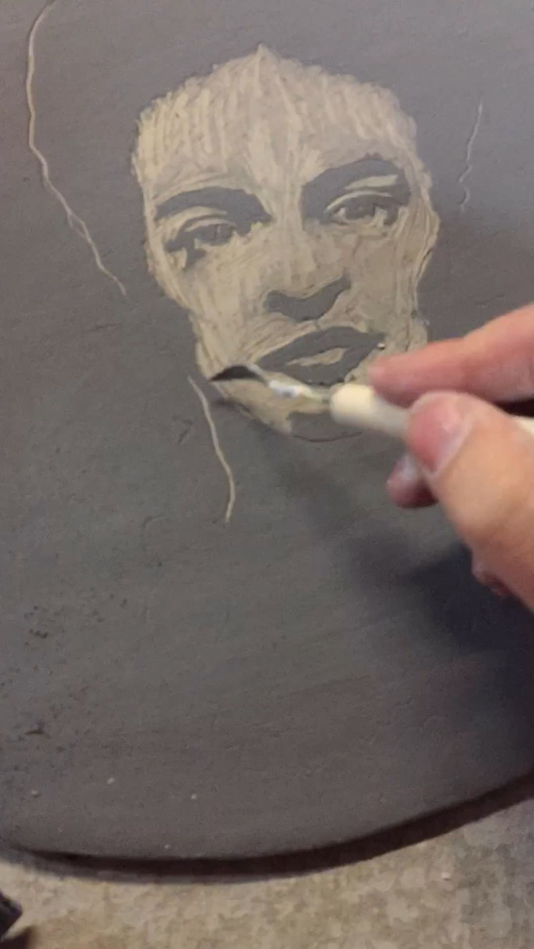 Making a Frida Tile - revealing the image using sgraffito technique.