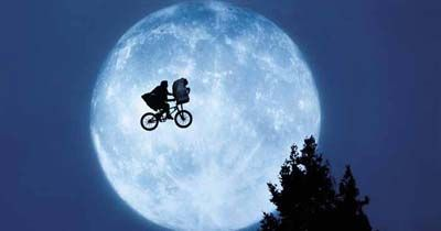 Empire called Elliott and E.T.'s flight to the forest the most magical moment in cinema. The image of Elliot and E.T. encircled by the moon is now the symbol for Spielberg's film and television company Amblin Entertainment.