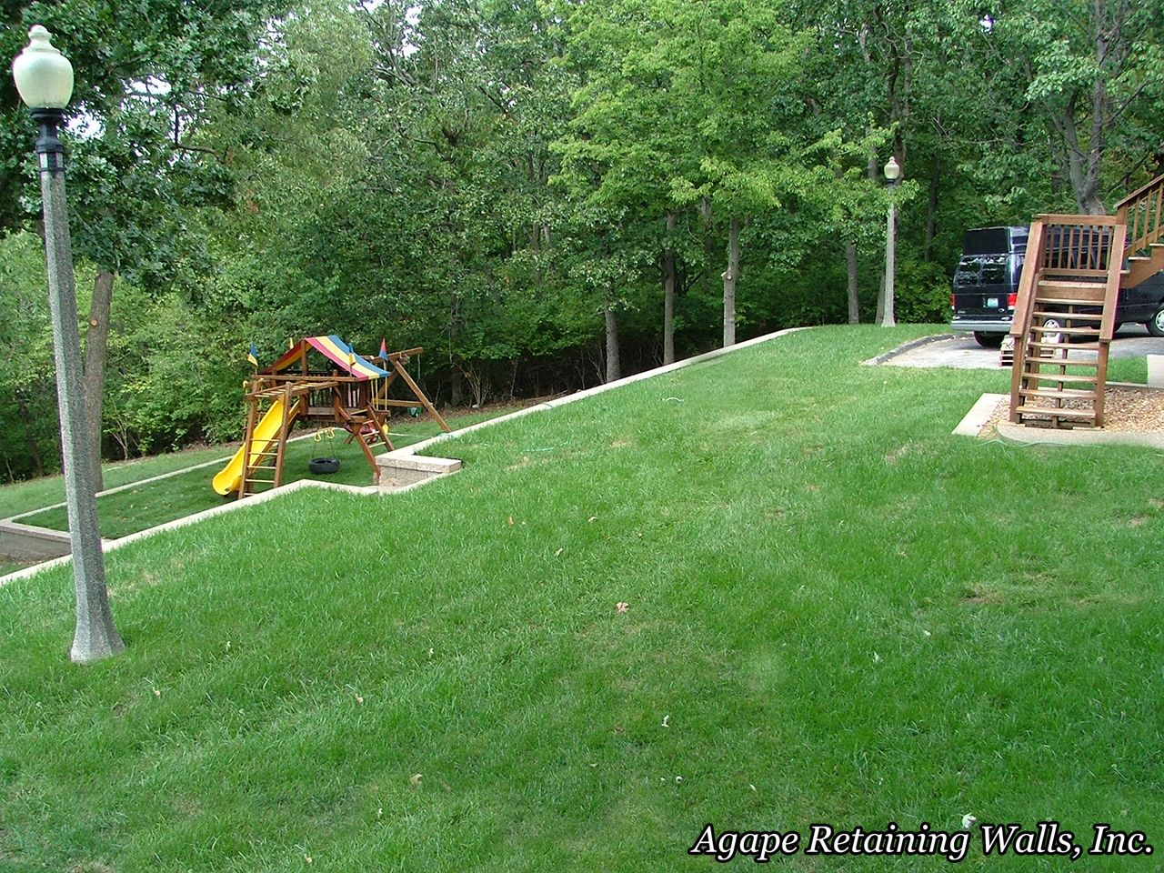 playset on sloped lower yard with retaining wall ... on Retaining Wall Ideas For Sloped Backyard id=57881