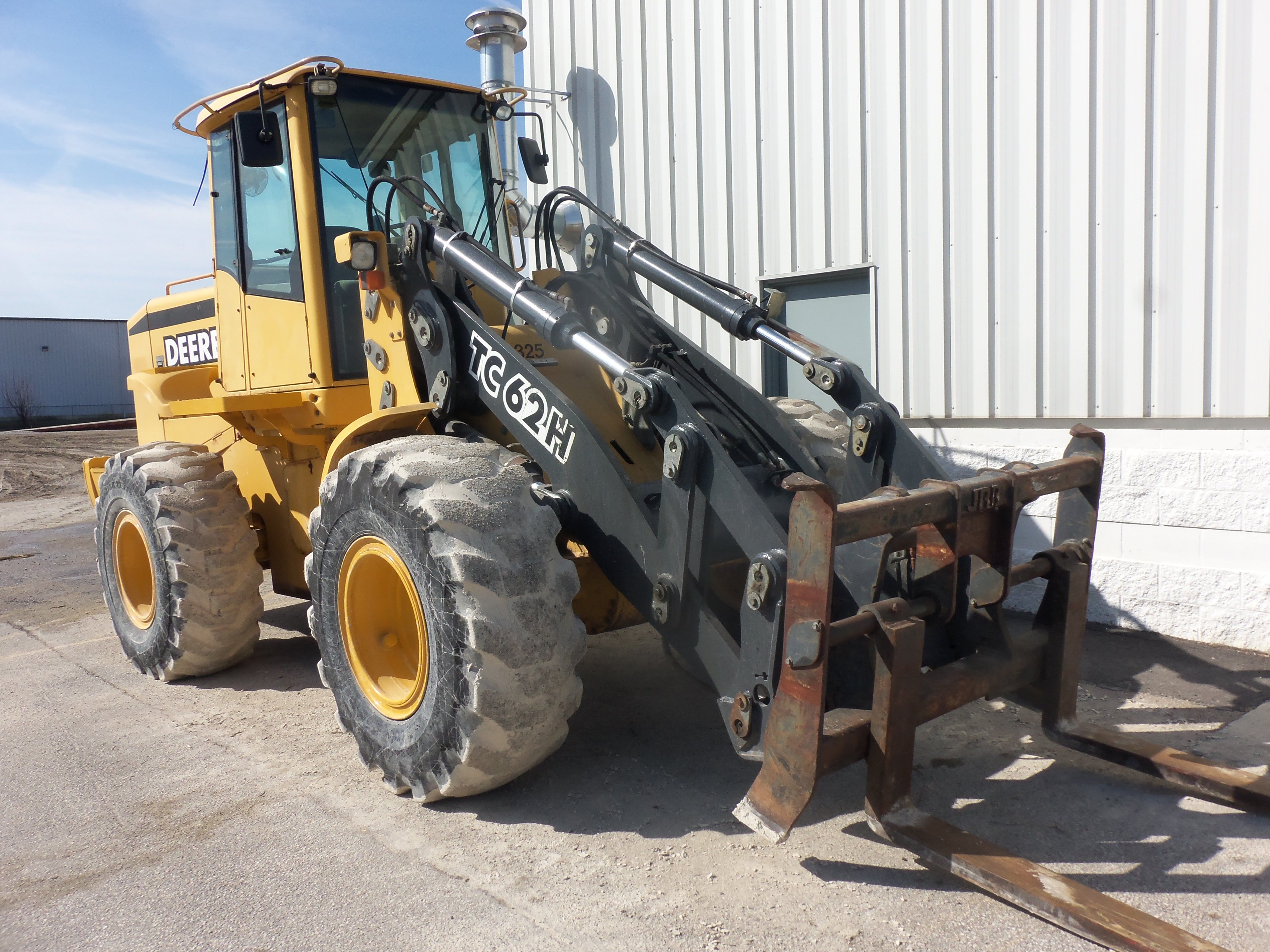 JOhn Deere TC62H Tool Carrier.172 gross,160 net hp from a turbocharged 414  cid diesel.29,651 lbs,10-10 hght,3.6 yards.This is based on the 624H wheel  loader