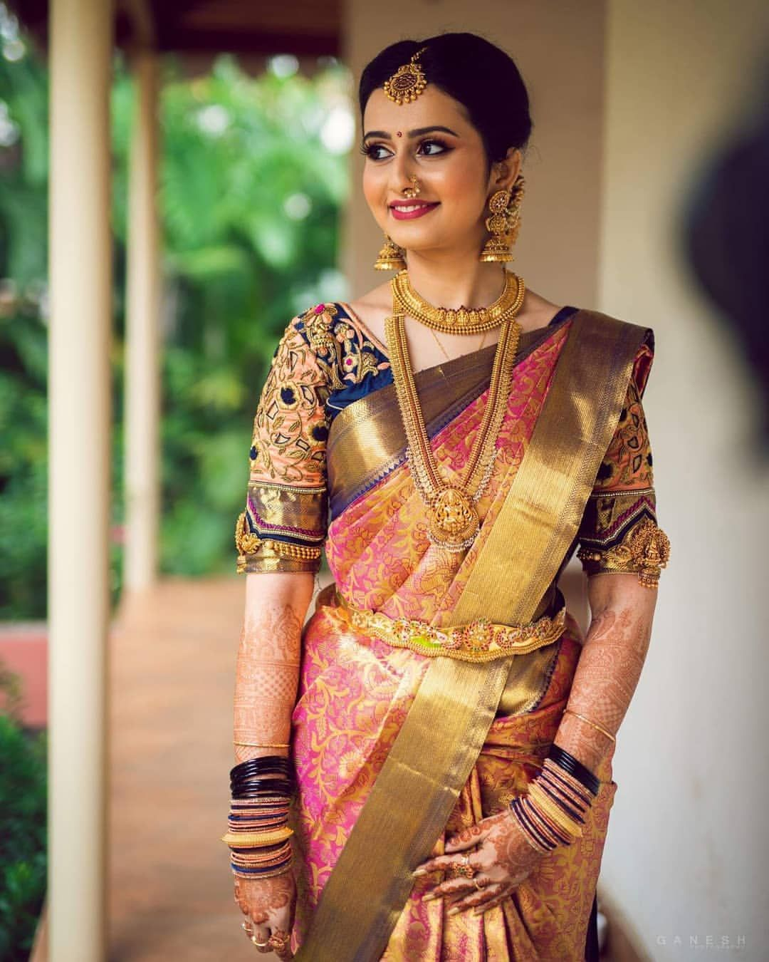 South Indian bride. Gold Indian bridal jewelry.Temple jewelry. Jhumkis.Pink  silk kanch… | South indian bride saree, Wedding saree indian, South indian  wedding saree