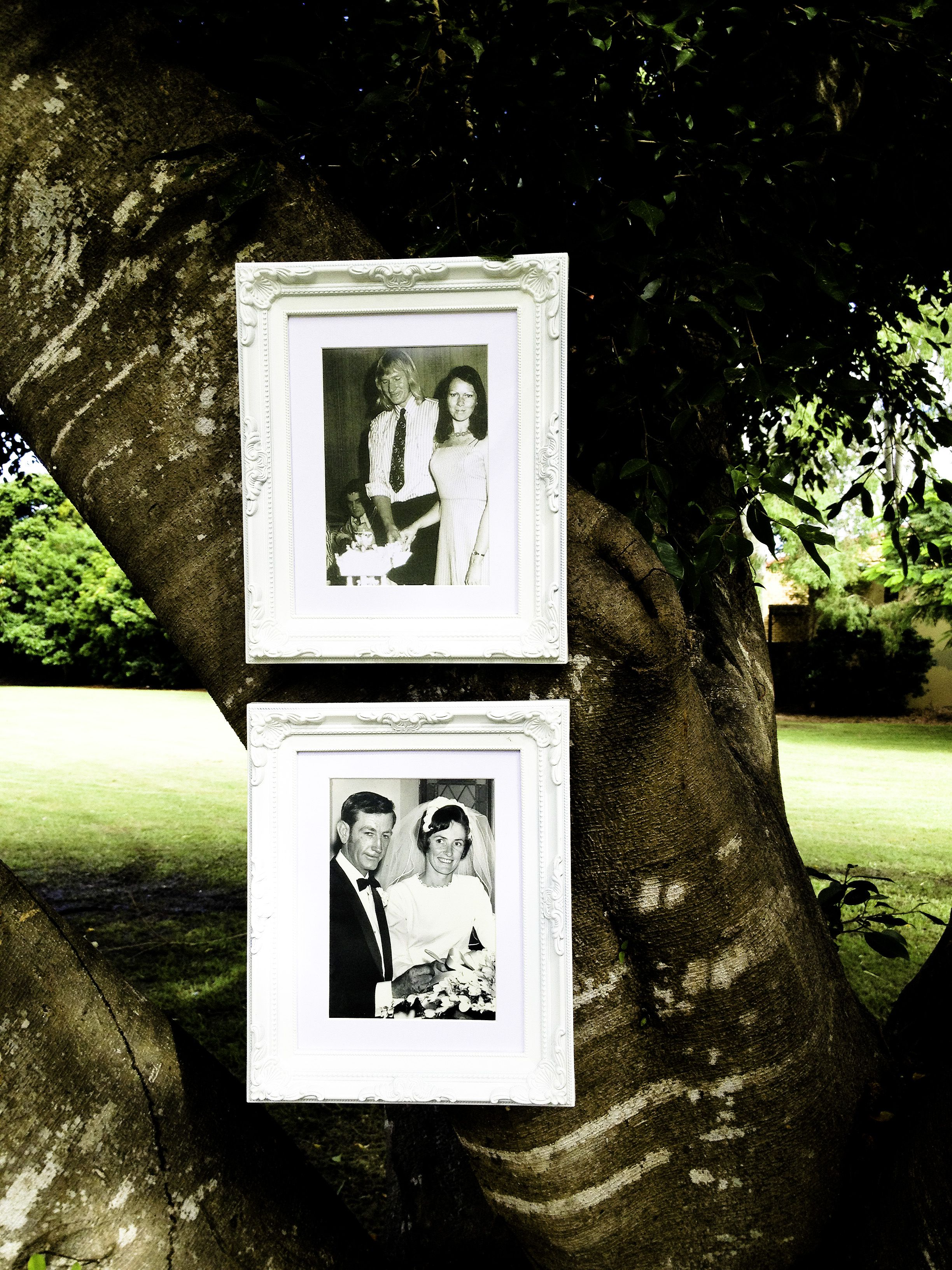 Hanging two frames with your parents wedding pics at your ceremony