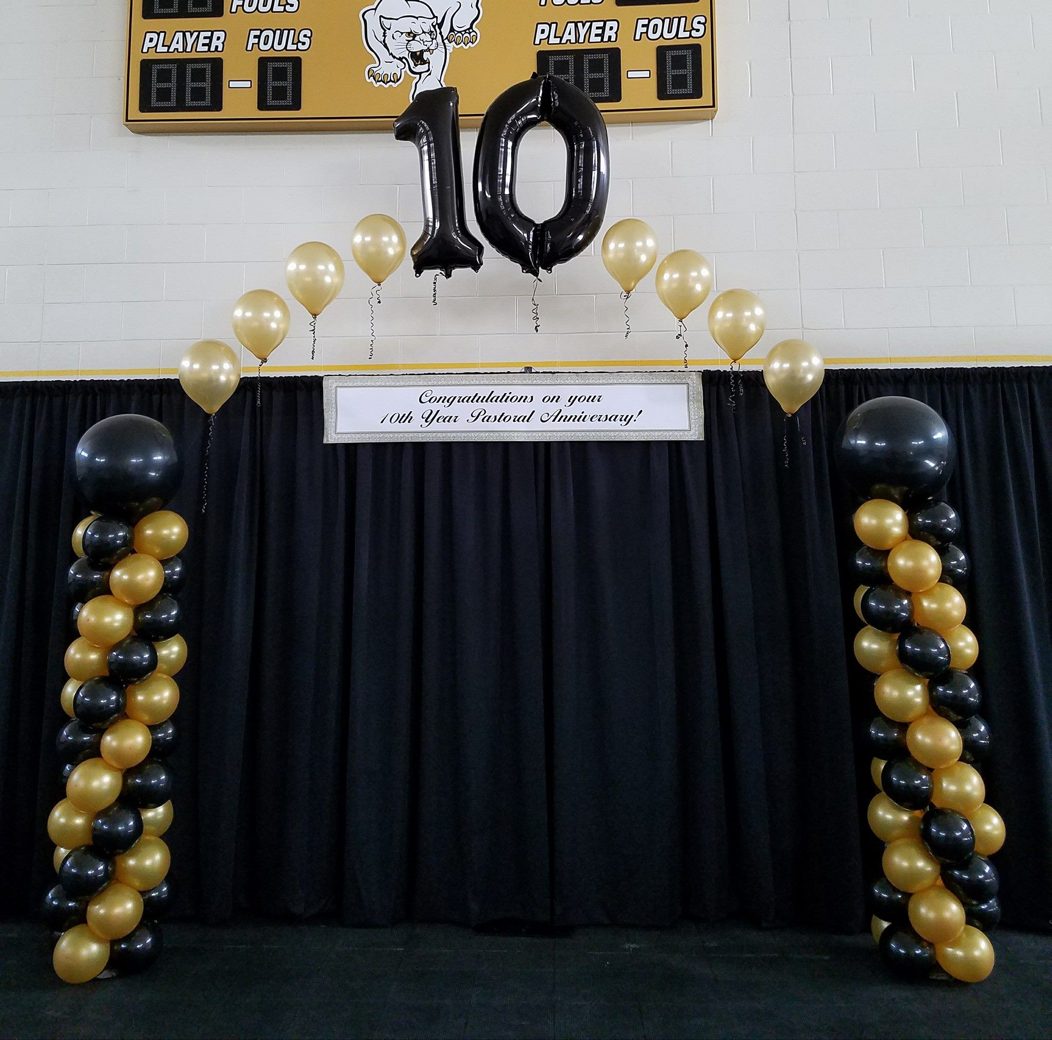 Black An Gold Balloon Decor For A 10 Year Church Anniversary