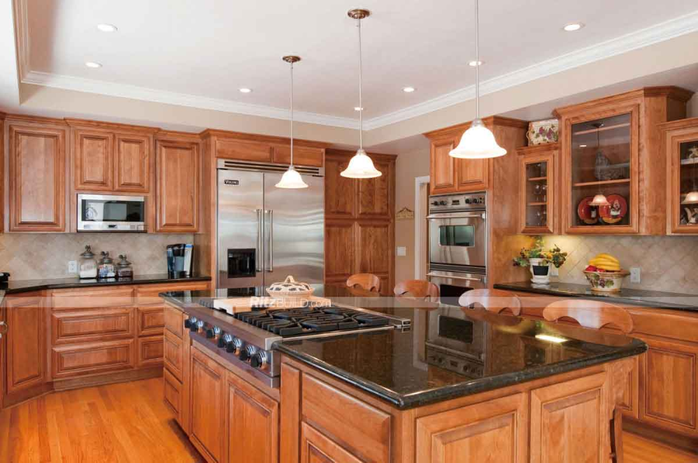 Honey Oak Kitchen With Black Granite Countertops