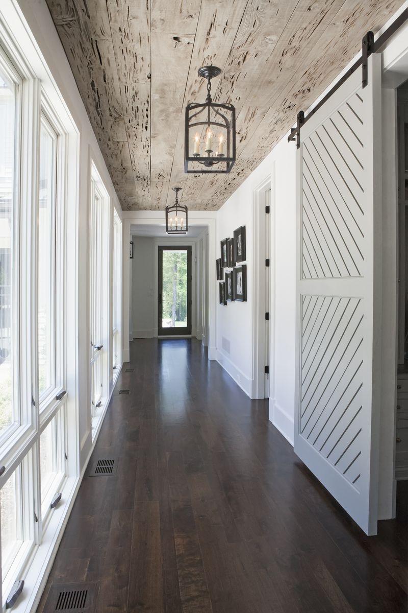 Hallway lighting modern  Hallway love the windows lighting plank ceiling and sliding doors