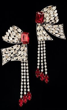 Ruby and diamond earring with a dangling spray