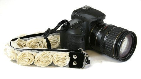 Hey, I found this really awesome Etsy listing at http://www.etsy.com/listing/113625758/cream-organza-floral-slr-camera-strap