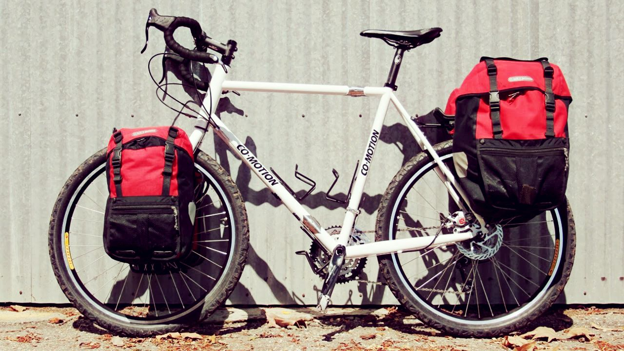 Touring Bicycles Are Usually Equipped With Luggage Racks Front And