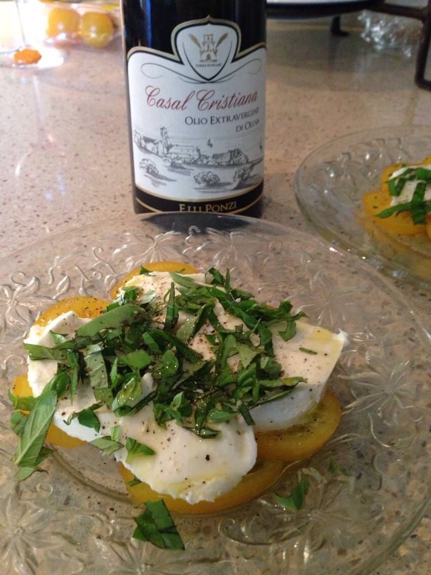 Yellow tomatoes are a nice summer variation for caprese salad. Finished off with Casal Cristiana Italian Extra Virgin Olive Oil. A healthy and tasty way to enjoy summer!