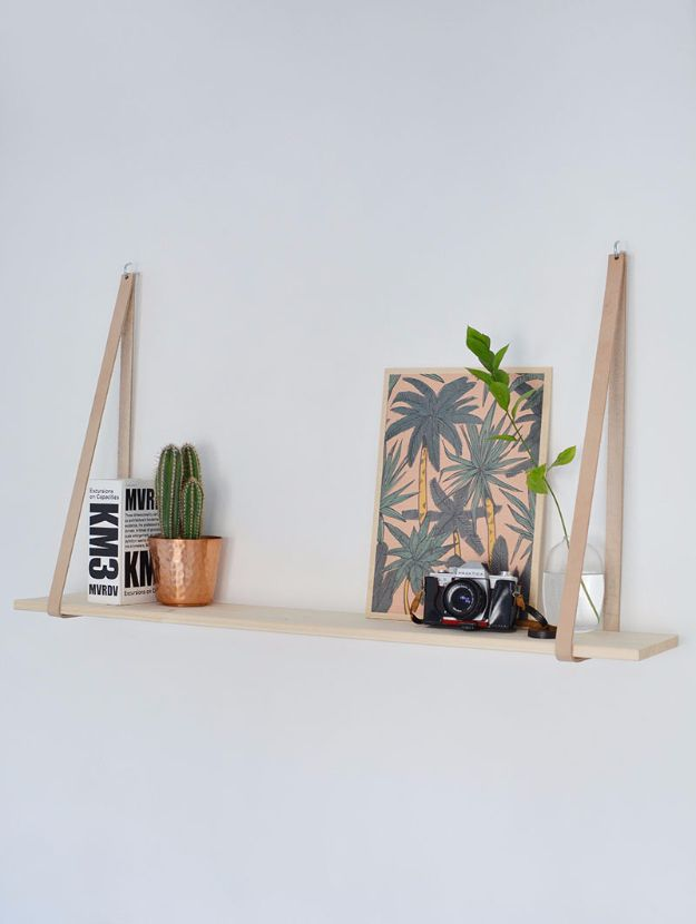 DIY Shelves and Do It Yourself Shelving Ideas - Easy Leather Strap Hanging Shelf - Easy Step by Step Shelf Projects for Bedroom, Bathroom, Closet, Wall, Kitchen and Apartment. Floating Units, Rustic Pallet Looks and Simple Storage Plans http://diyjoy.com/diy-shelving-projects