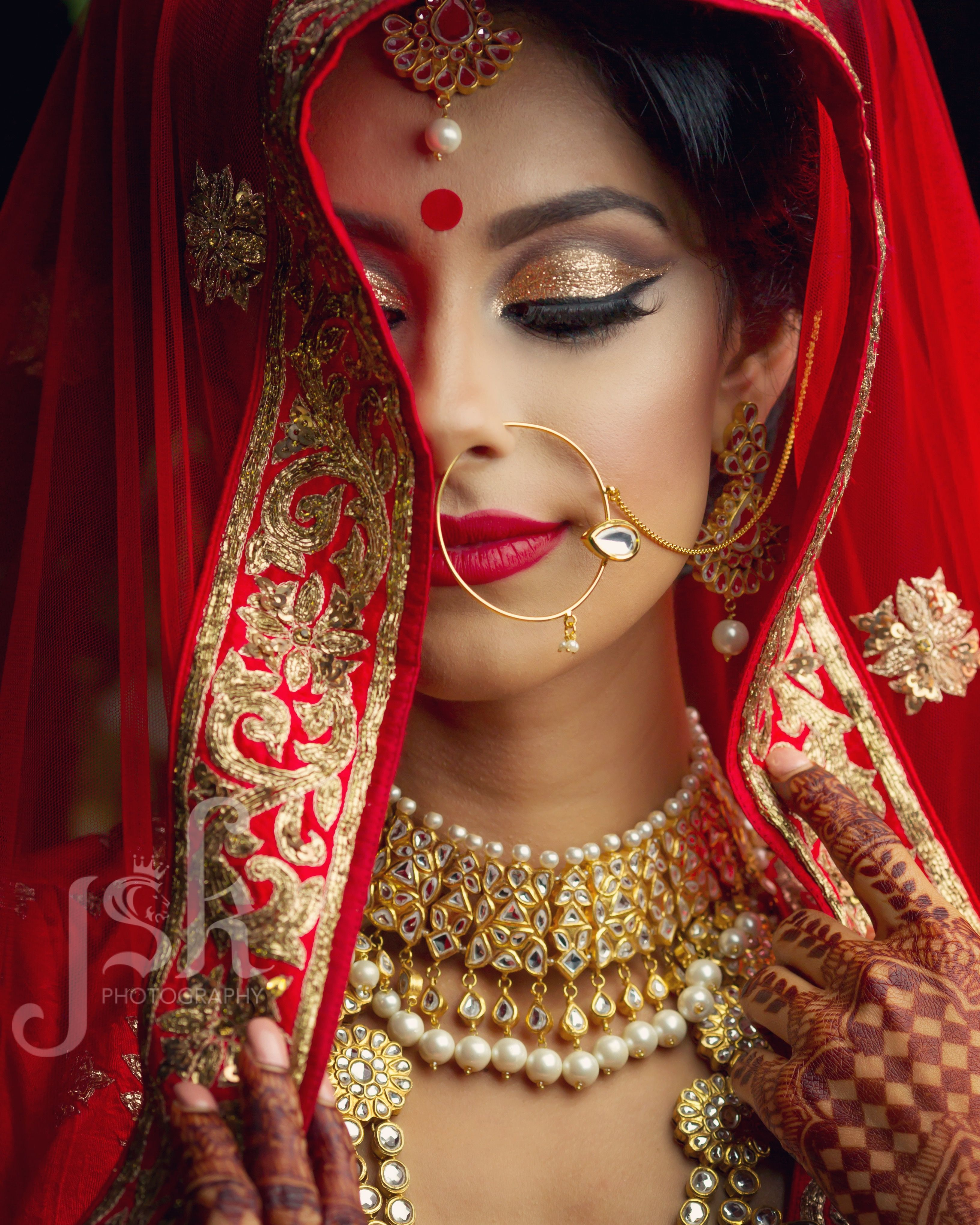 editorial photo shoot by jsk photography. traditional red lengha