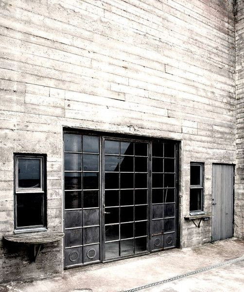 Marvelous Industrial Metal Windows And Door Set Into A Vast Concrete Wall Discover