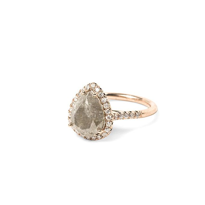Raw grey diamond engagement ring set in yellow gold,
