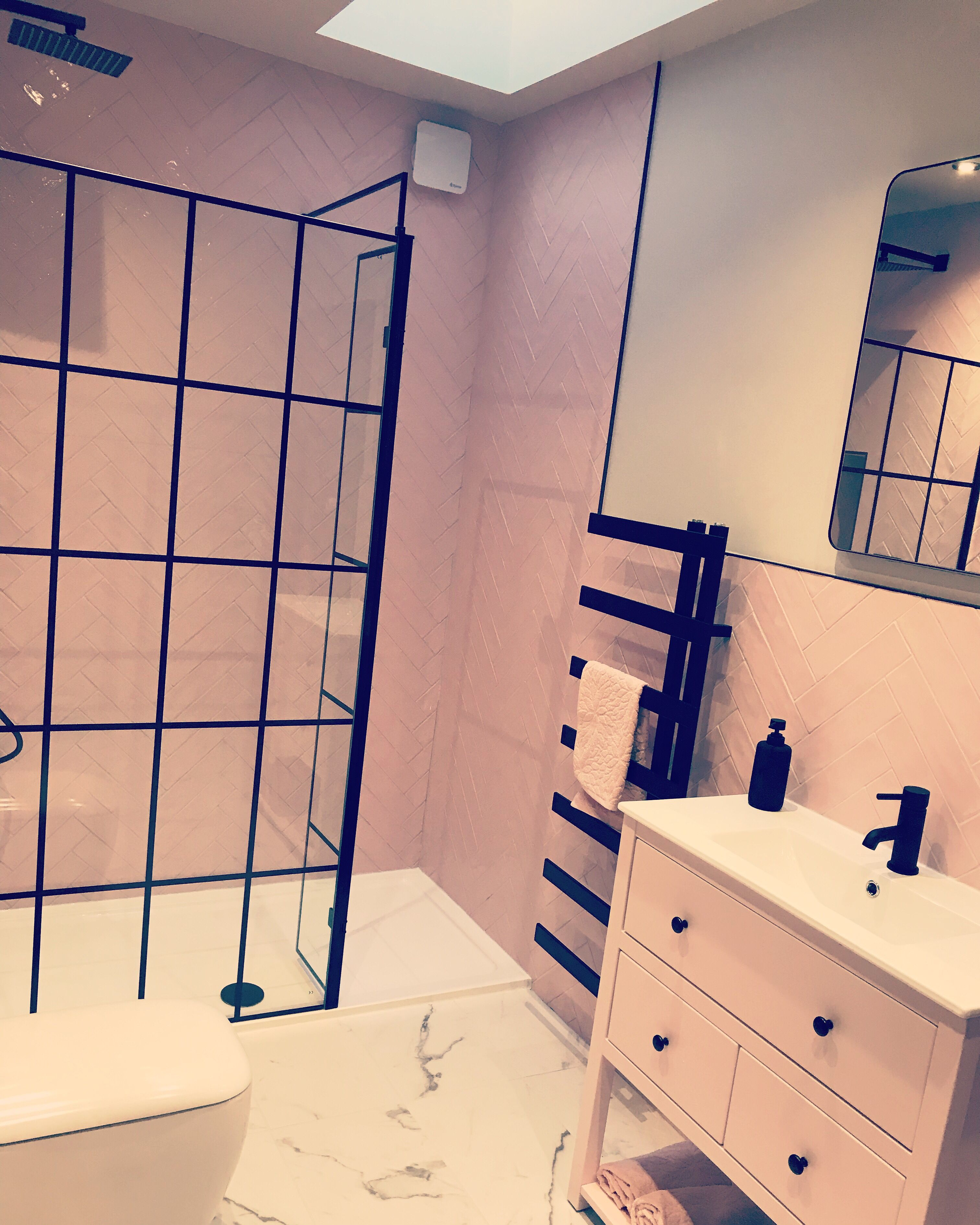 Girls en suite bathroom. Pink herringbone tiles with black ...