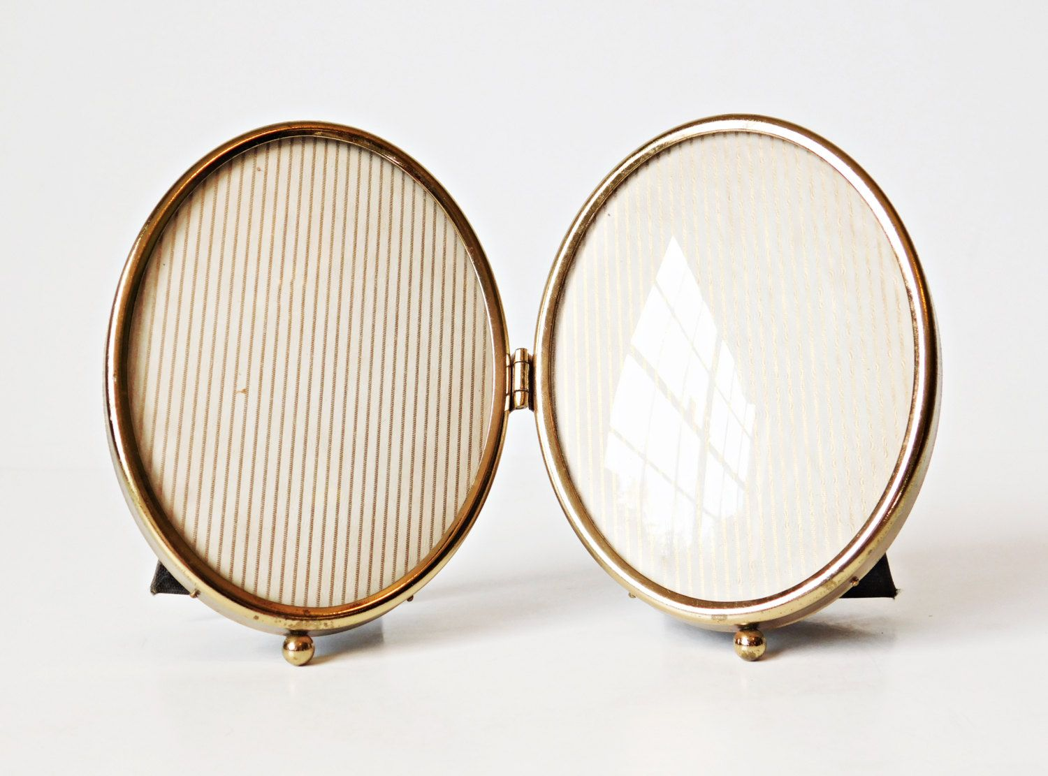 Vintage oval hinged metal double picture frame with convex bubble vintage oval hinged metal double picture frame with convex bubble glass footed gold photo frame jeuxipadfo Image collections