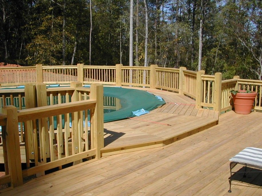 Stunning Above Ground Pool Decks In Irregular Shape Big Above Ground Pool Decks With Lounge Wood Dec Pool Deck Plans Wood Pool Deck Backyard Pool Landscaping