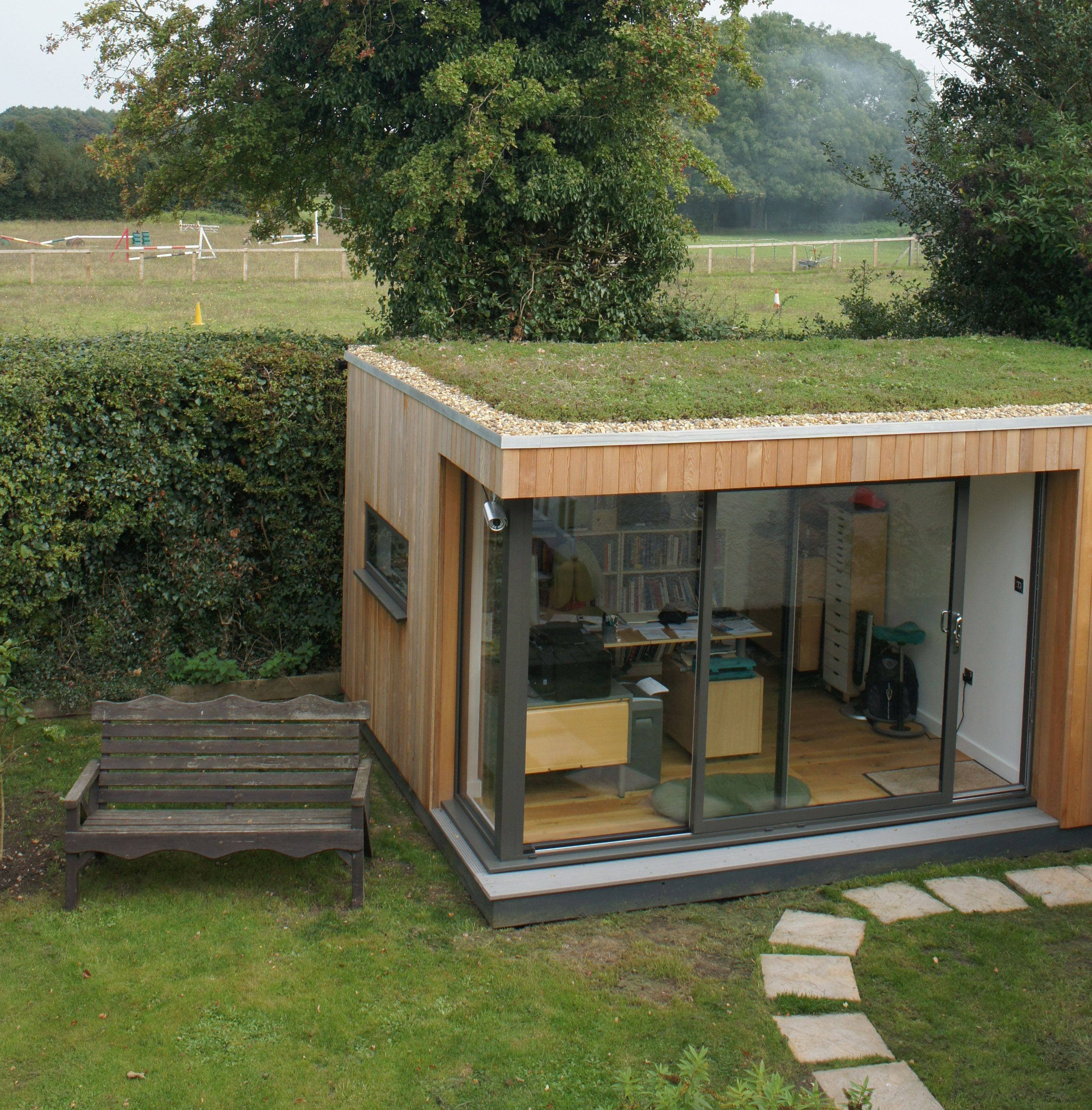 outdoor garden office. this client loves his garden room sedum roof so much he smiles every day outdoor office