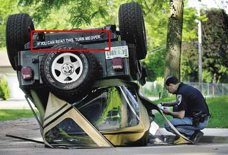 Funny bumper sticker car upside down
