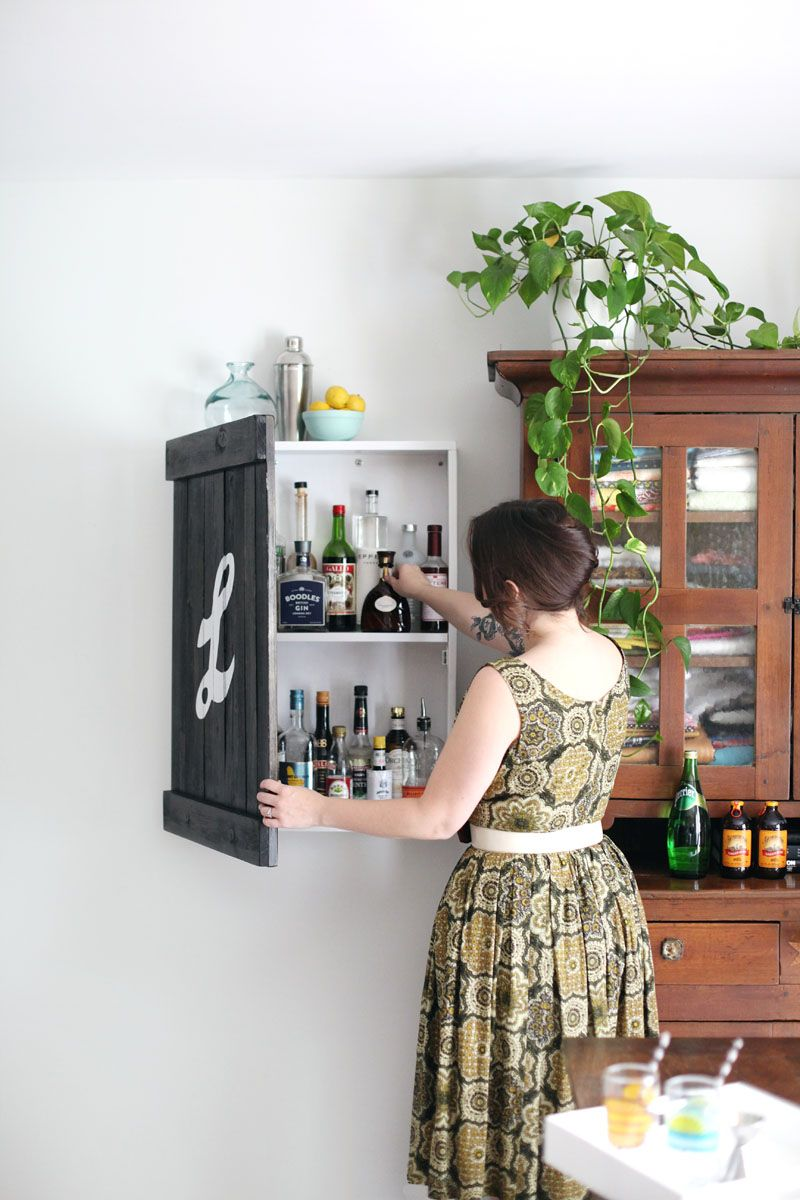 No Room For A Bar Cart In Your Home Build This Wall Mounted Liquor Cabinet That Looks Like Vintage Sign
