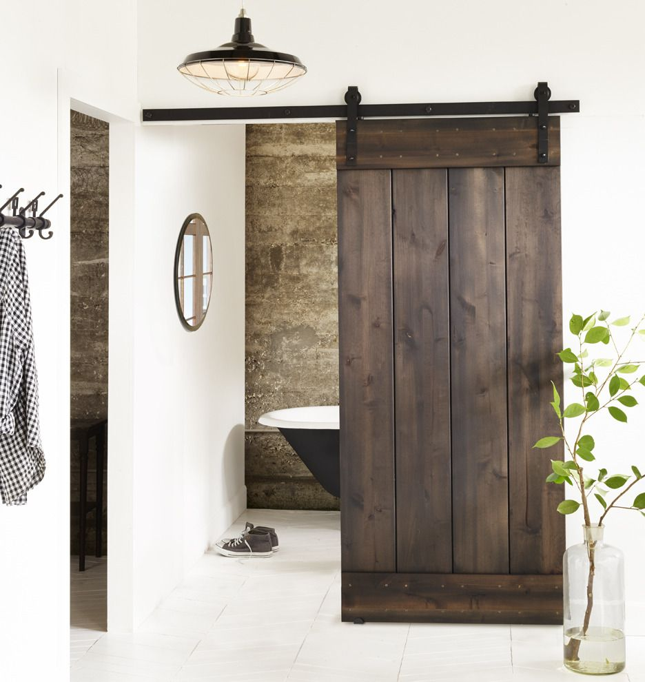 5 1 2 Clawfoot Tub With Black Exterior Plank Door Barn Doors Sliding Diy Barn Door