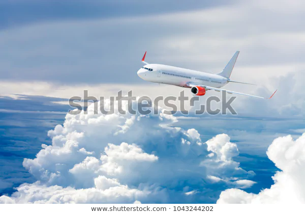 White Airplane Flying Above Cloud Stock Photo (Edit Now) 1043244202