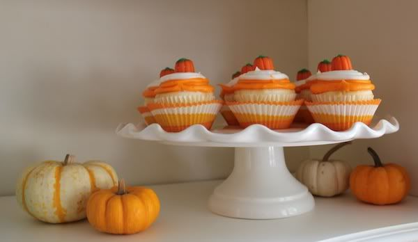 cupcakes with candy pumpkins on top