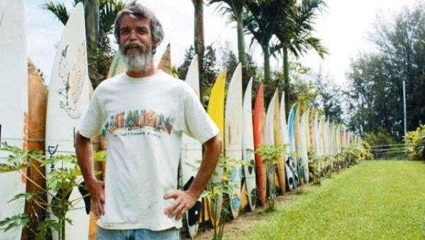 """6fce4dda782 Owner Donald """"DJ"""" Dettloff stands beside his Famous Surfboard Fence in  Maui"""