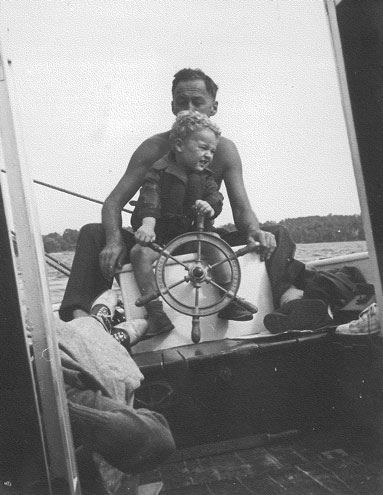 Mr. T, Pixley's and Ted's father, at a sailboat's helm (it's not a snipe) on Missisquoi Bay, summer of 1937. The kid in front of him with the hair (who now has none) is Ted.   by Tyler Place Family Resort #TPbucketlist