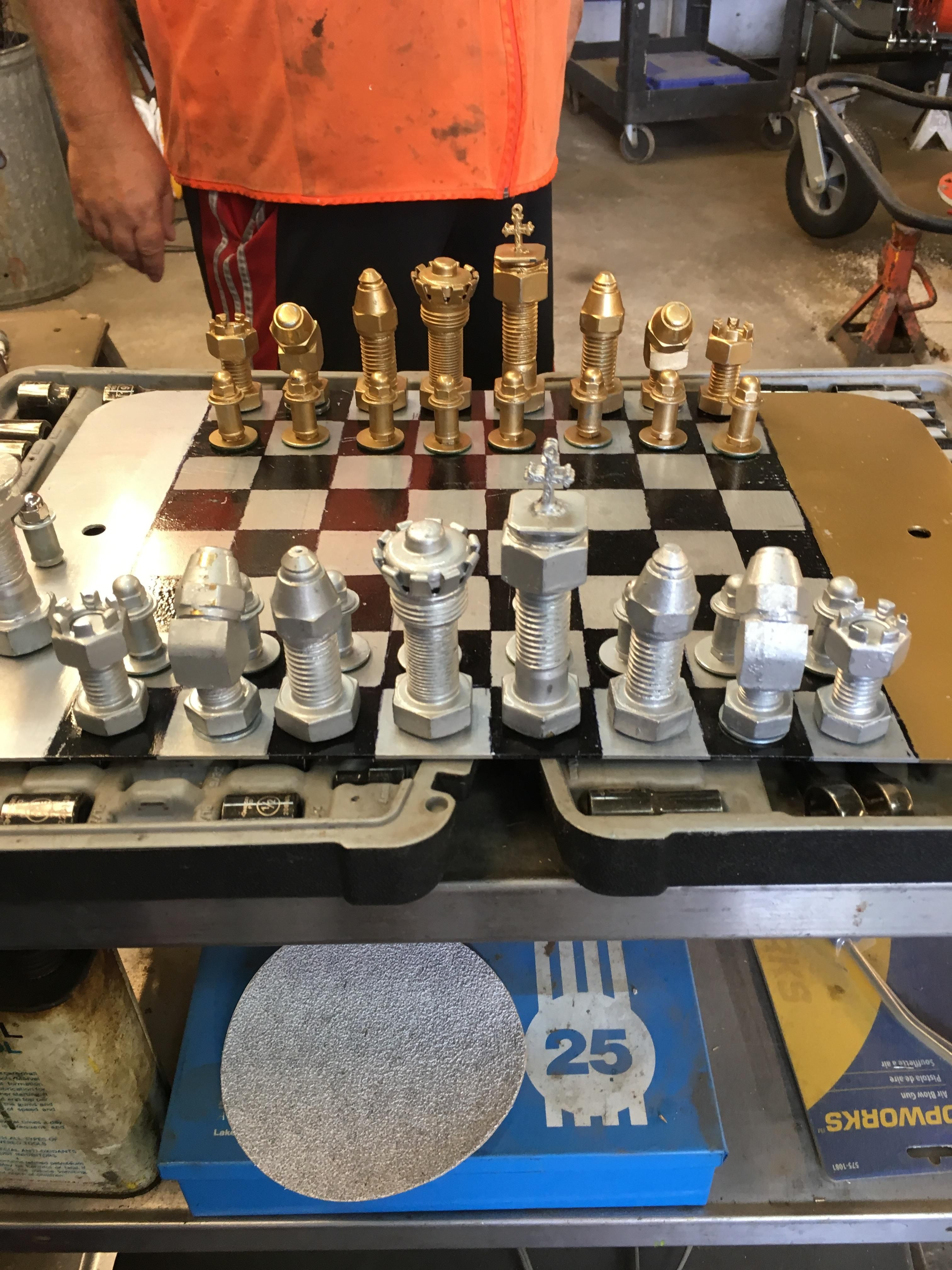 A chess set my coworker made out of leftover nuts and