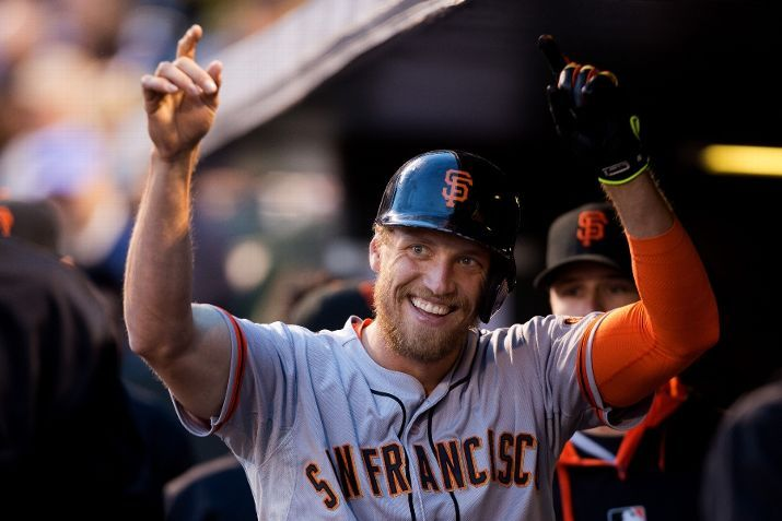 DENVER, CO - MAY 21: Hunter Pence #8 of the San Francisco Giants celebrates in the dugout after hitting a home run during the fourth inning against the Colorado Rockies at Coors Field on May 21, 2014 in Denver, Colorado. The Giants defeated the Rockies 5-1. (Photo by Justin Edmonds/Getty Images)