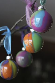 Pour-Painted Christmas Ornaments. Stunning to look at and an easy Christmas craft for kids (or grownups) to make - happy hooligans